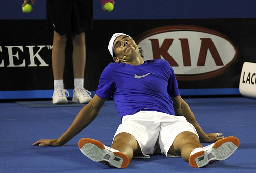 "Nadal reacts during the fundraising exhibition ""Hit for Haiti"" ahead of the Australian Open in Melbourne"