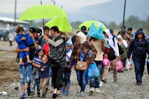 On 10 September, children, women and men who have fled their homes amid the ongoing refugee and migrant crisis walk along a rocky path, on a rainy day near the town of Gevgelija, on the border with Greece. Many are using umbrellas, hooded articles of clothing and other items in an attempt to stay dry. In late August 2015 in the former Yugoslav Republic of Macedonia, more than 52,000 people have been registered at the border by police near the town of Gevgelija, after entering from Greece, since June 2015. Since July 2015, the rate of refugees and migrants transiting through the country has increased to approximately 2,000 to 3000 people per day. Women and children now account for nearly one third of arrivals. An estimated 12 per cent of the women are pregnant. Many are escaping conflict and insecurity in their home countries of Afghanistan, Iraq, Pakistan and the Syrian Arab Republic. There are children of all ages traveling with their families. Some are unaccompanied minors aged 16?18 years who are traveling in groups with friends. They are arriving in the country from Greece, transiting to Serbia and further to Hungary, from where they generally aim to reach other countries in the European Union.