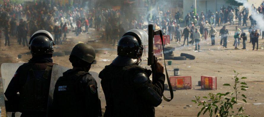 Fotos atestiguan uso de armas en enfrentamiento contra la CNTE en Oaxaca
