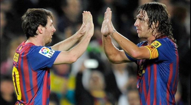 Lionel Messi y Carles Puyol