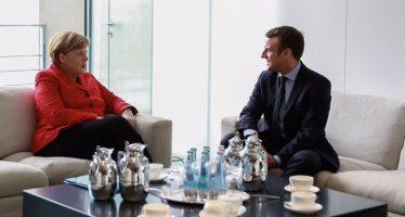 Merkel y Macron, dispuestos a cambiar tratados para que funcione bien la zona euro