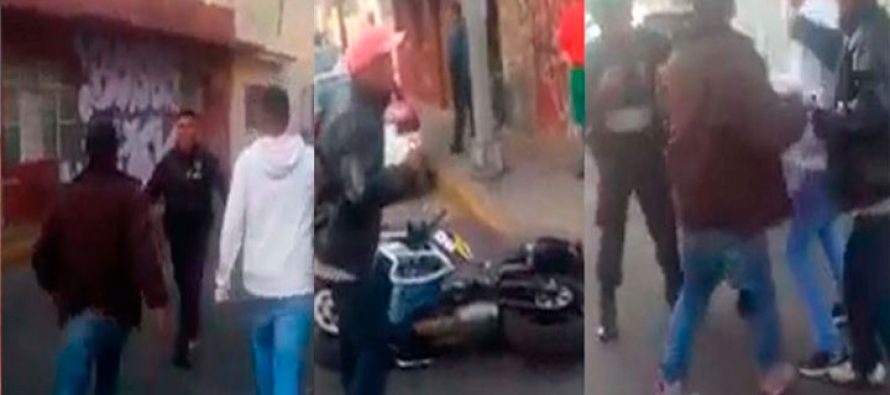 Policía dispara a pareja que huía en vehículo; colonos tratan de agredir al policía