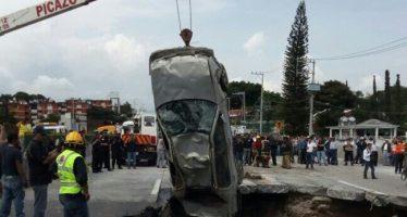 Víctimas de socavón murieron de asfixia, bajo los escombros