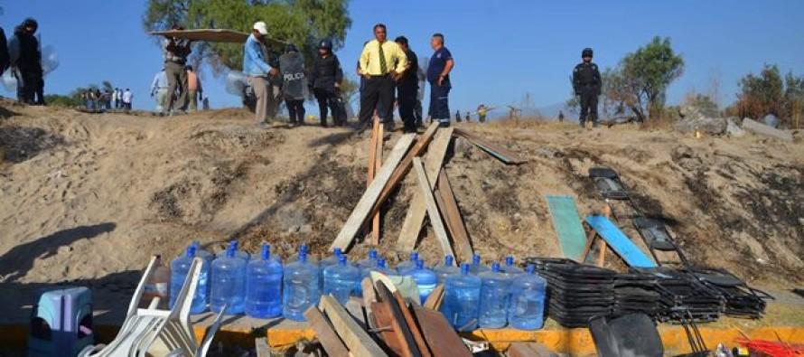 Desalojan granaderos a 150 familias de un predio en Chalco