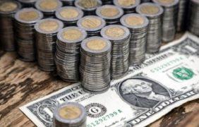 Promedia dólar 18.55 pesos a la venta en aeropuerto capitalino