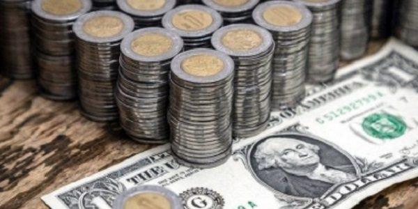 Pesos y dólar. (Notimex)